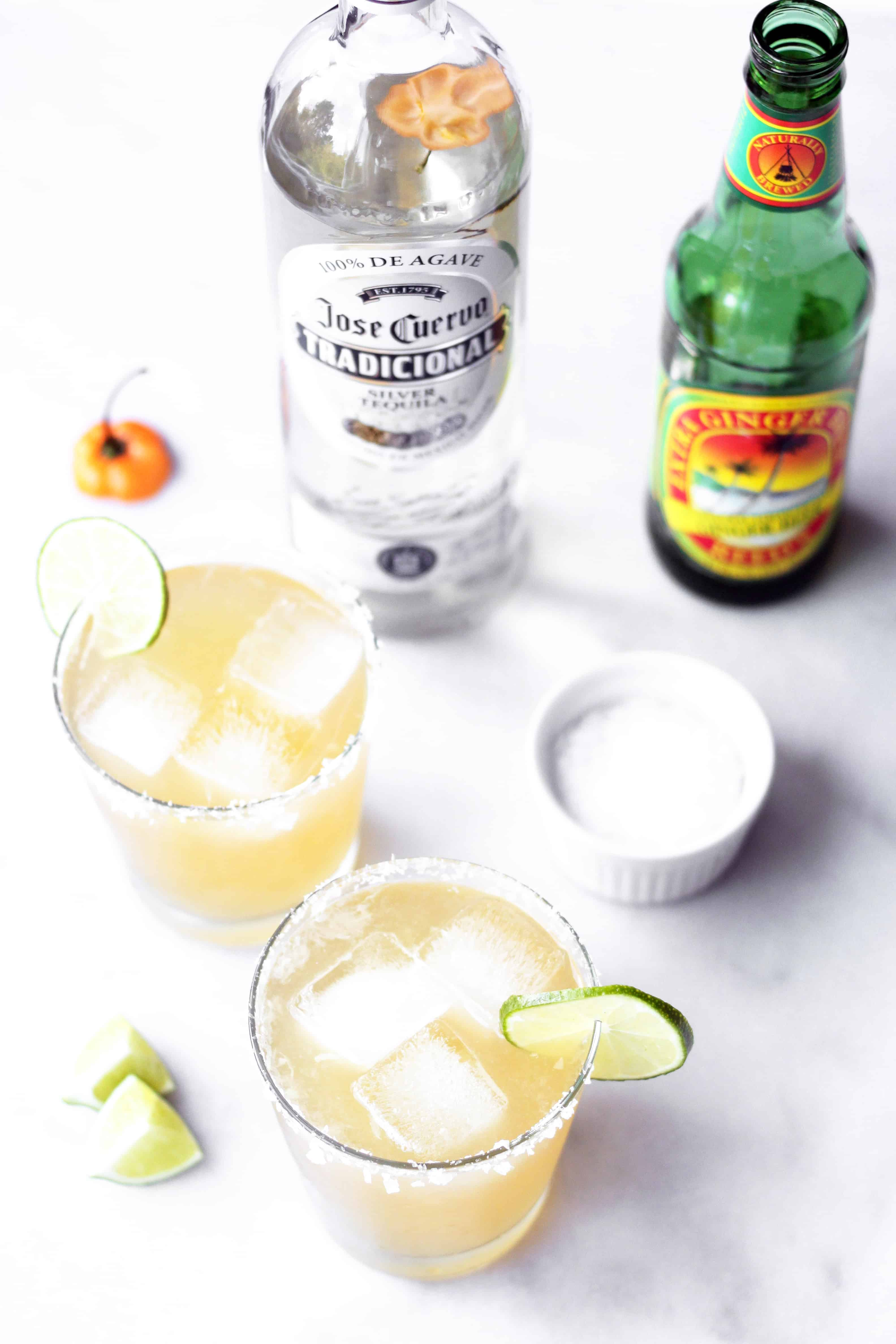 Spicy Habanero ginger beer margarita in glass with ice and lime and salted rim