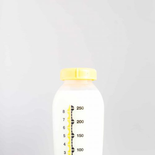 Pumped breastmilk in milk storage bottle