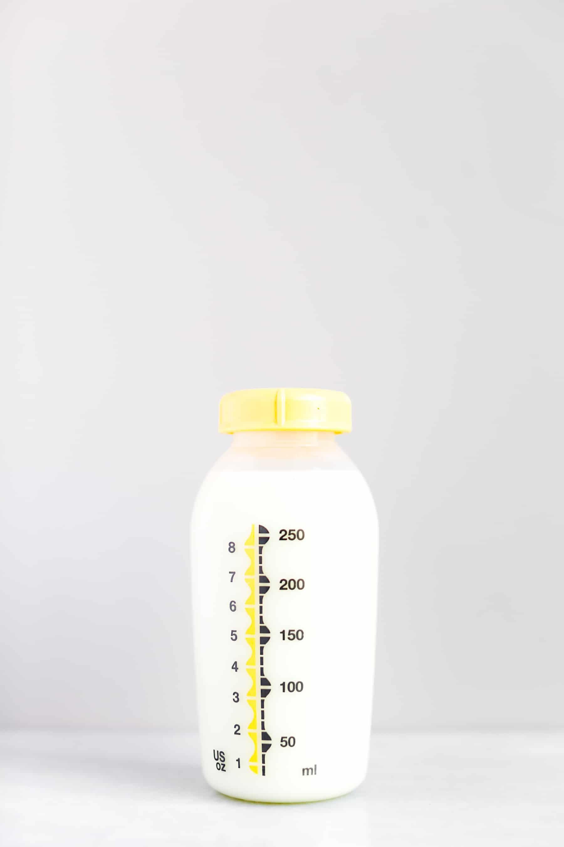 Pumped breastmilk in milk storage bottle